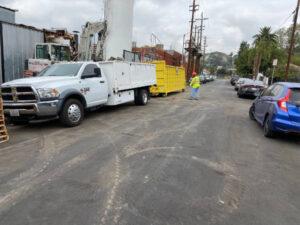 sweeping road of demolition debris